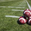 Footballs on football field — Foto Stock #40859527