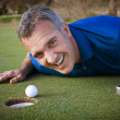 Stock Photo: Male Golfer missing putt