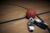 Basketball Court with ball and shoes — Stock Photo