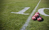 Footballs positioned together — Foto Stock