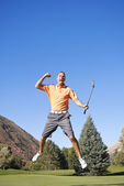 Excited Golfer jumping in the air — Stock Photo