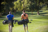 Golfers walking on the Golf Course — Stock Photo