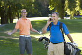 Talking on the cell phone while playing golf is annoying — Stock Photo