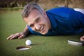 Male Golfer missing the putt — Stock Photo