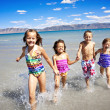 Stock Photo: Children playing in the Ocean