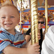 Child on Merry-Go-Round — Stock Photo #41216733
