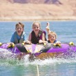 Stock Photo: Kids having fun on lake