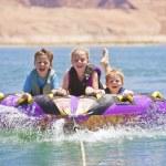 Kids having fun on the lake — Stock Photo