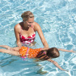 Little Girl learning to swim — Stock Photo #41217977
