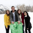 Young Adults snow sledding — Stock Photo #41219879