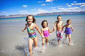 Children playing in the Ocean — Stock Photo