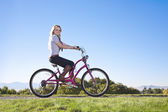 Young Woman on a bike ride — Stock Photo