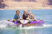 Kids having fun on the lake — Stock Photo