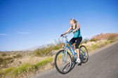 Fit Female on a Bike Ride — Stock Photo
