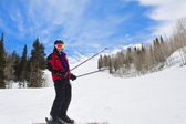 Male skier on the ski hill — Stock Photo