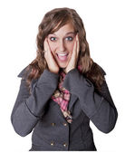 Attractive young woman wearing a winter jacket with a surprised or elated expression. Isolated on a white background — Stock Photo