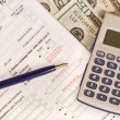 Stock Photo: Tax form, calculator and pen