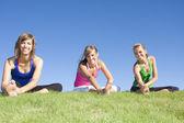 Three women stretching — Photo