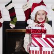 Cute young girl holding Christmas Gifts — Stock Photo #41535943