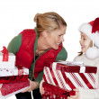 Woman Giving Christmas Presents — Stock Photo #41536121
