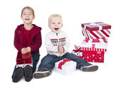 Children opening their Christmas Gifts — Stock Photo