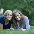Young women on the grass — Stock Photo