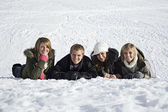 Young adults in the Snow — Stock Photo