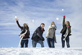Young adults snowball fighting — Stock Photo