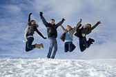Young people jumping on the snow — Stock Photo