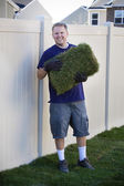 Man with New Sod Grass — Stock Photo