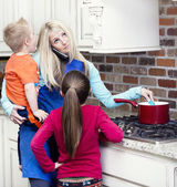 Overwhelmed and frustrated Mom in the kitchen — Stock Photo