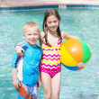 Kids playing with ball in the pool — Stock Photo #46223961