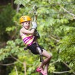 Young girl on a jungle zipline — Stock Photo #46225789
