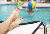 Beautiful Feet by the swimming pool — Stock Photo