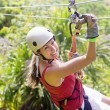 Woman going on a jungle zipline adventure — Stock Photo #48832583