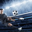 Hispanic Soccer Player kicking the ball — Stock Photo #48832987