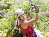 Woman going on a jungle zipline adventure — Stock Photo