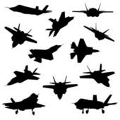 Fighter aircraft silhouettes — Stock Vector