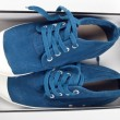 A pair of new blue shoes in a shoe box — Stock Photo