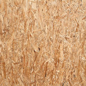 Recycled compressed wood chippings board — Stock Photo