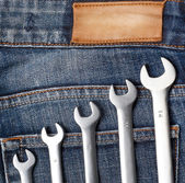 Wrenches on the jeans — Stock Photo