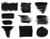 Çeşitli siyah beyaz zemin üzerine suluboya el boya fırça darbeleri yalıtılır kümesi. — Stok fotoğraf