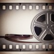 Old motion picture film reel with film strip. Vintage background — Stock Photo #25938451