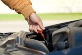 Car oil level check — Stock Photo