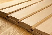 Wood planks are on a wooden board with sawdust — Stock Photo