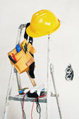Stepladder near the concrete wall and tools — Stock Photo