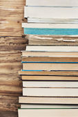 Books next to the wooden wall — Stock Photo