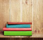 Books on the brown bookshelf — Stock Photo
