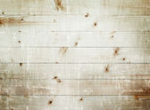 Light wooden planks texture with branch — Stock Photo