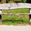 Old weathered wooden park bench — Stock Photo